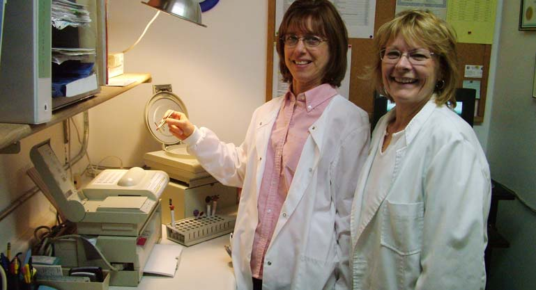 Mary Tadic and Cherie Mielke demonstrate the new QBC blood machine